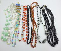 Nine vintage glass bead necklaces, one requires repair/re-stringing