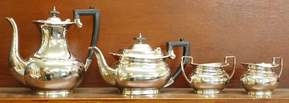 A Garrard of London four piece silver plated teaset, boxed