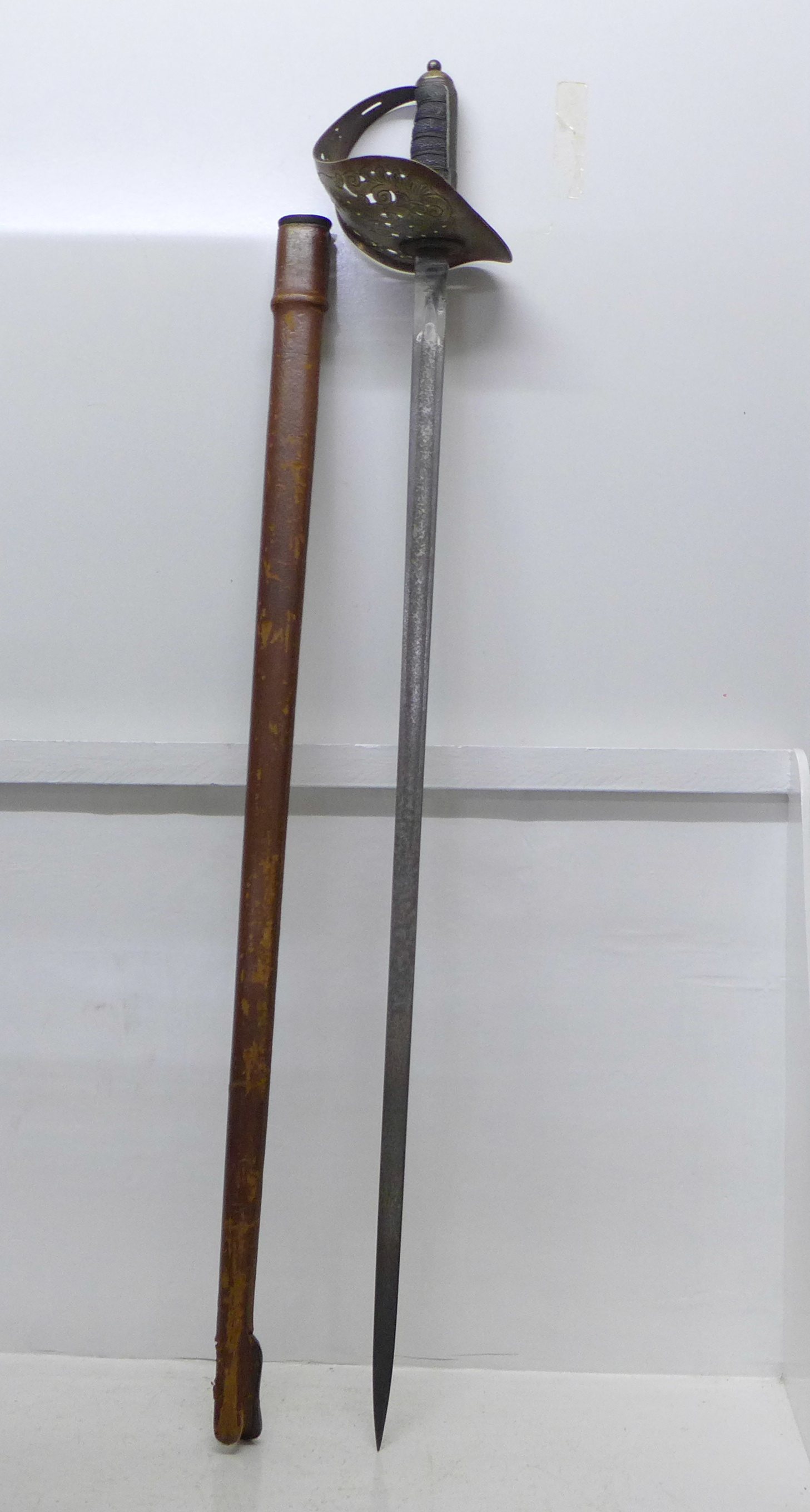 A George V officer's sword with scabbard, the blade marked James Deakin & Sons Limited, Sheffield,