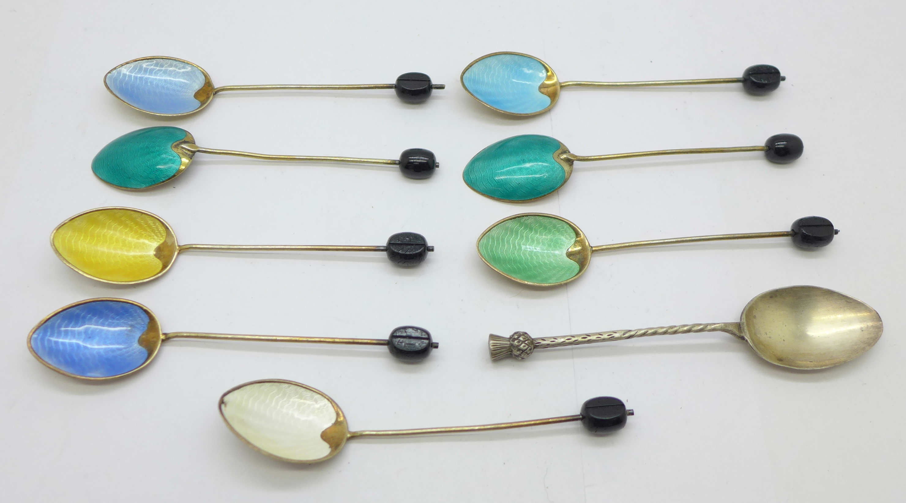 Eight silver and enamel coffee bean spoons, (6+2), and a silver thistle spoon, 72g
