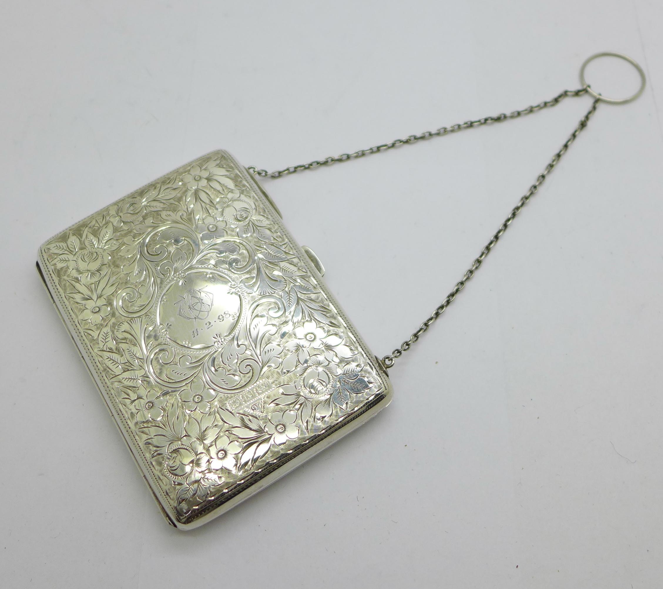 A late Victorian silver aide memoire purse, Joseph Gloster, Birmingham 1897, and a silver propelling
