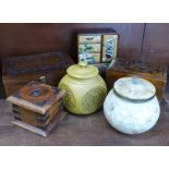 Three wooden boxes, a small chest and two lidded jars