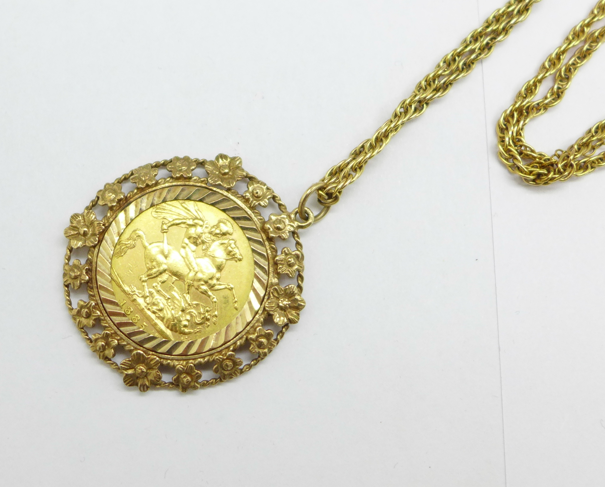 A Victorian 1885 full sovereign Melbourne mint, in a 9ct gold pendant mount and on a 9ct gold chain, - Image 2 of 3