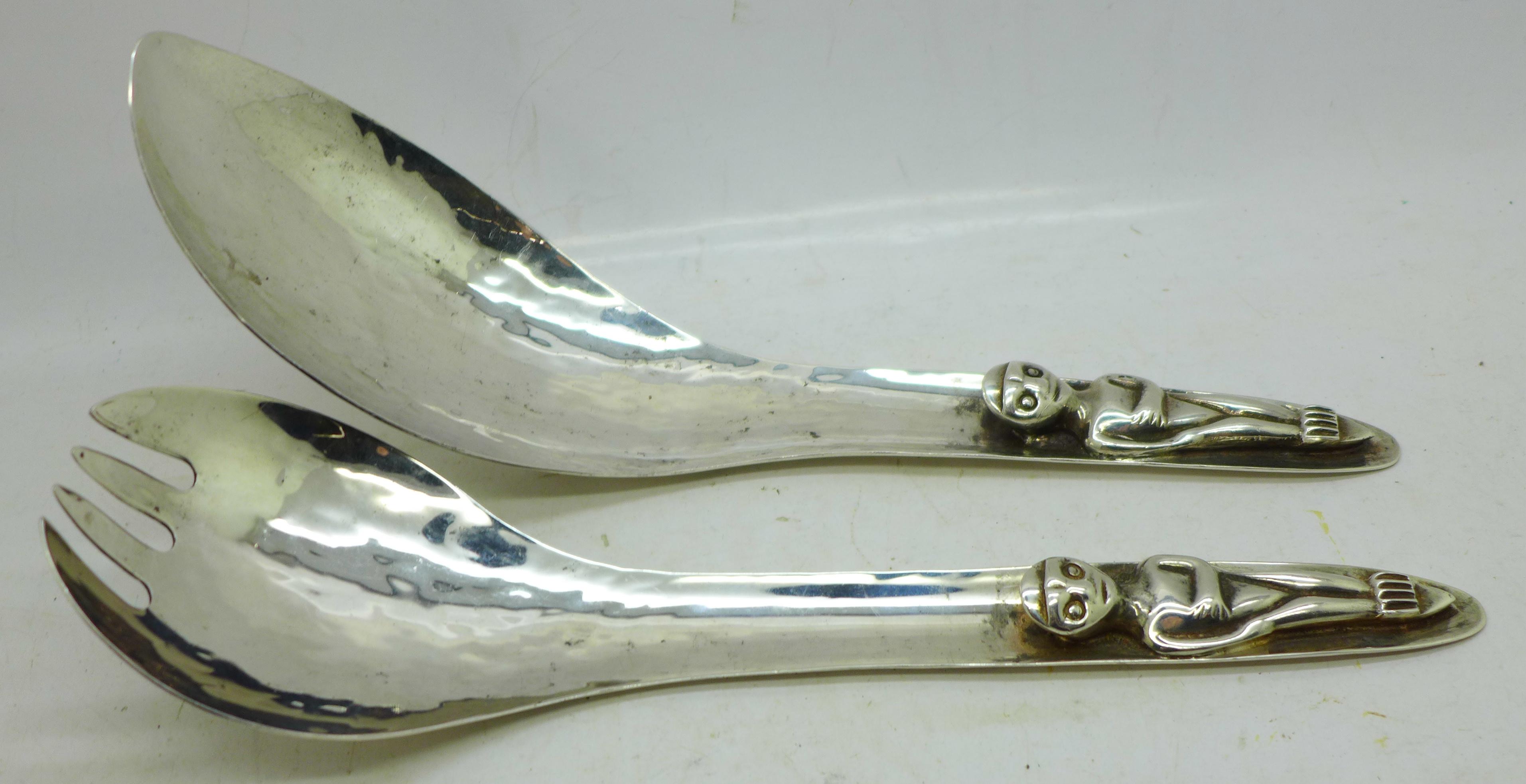 Two Canadian hammered Haida utensils, marked Acme Van. B.C.