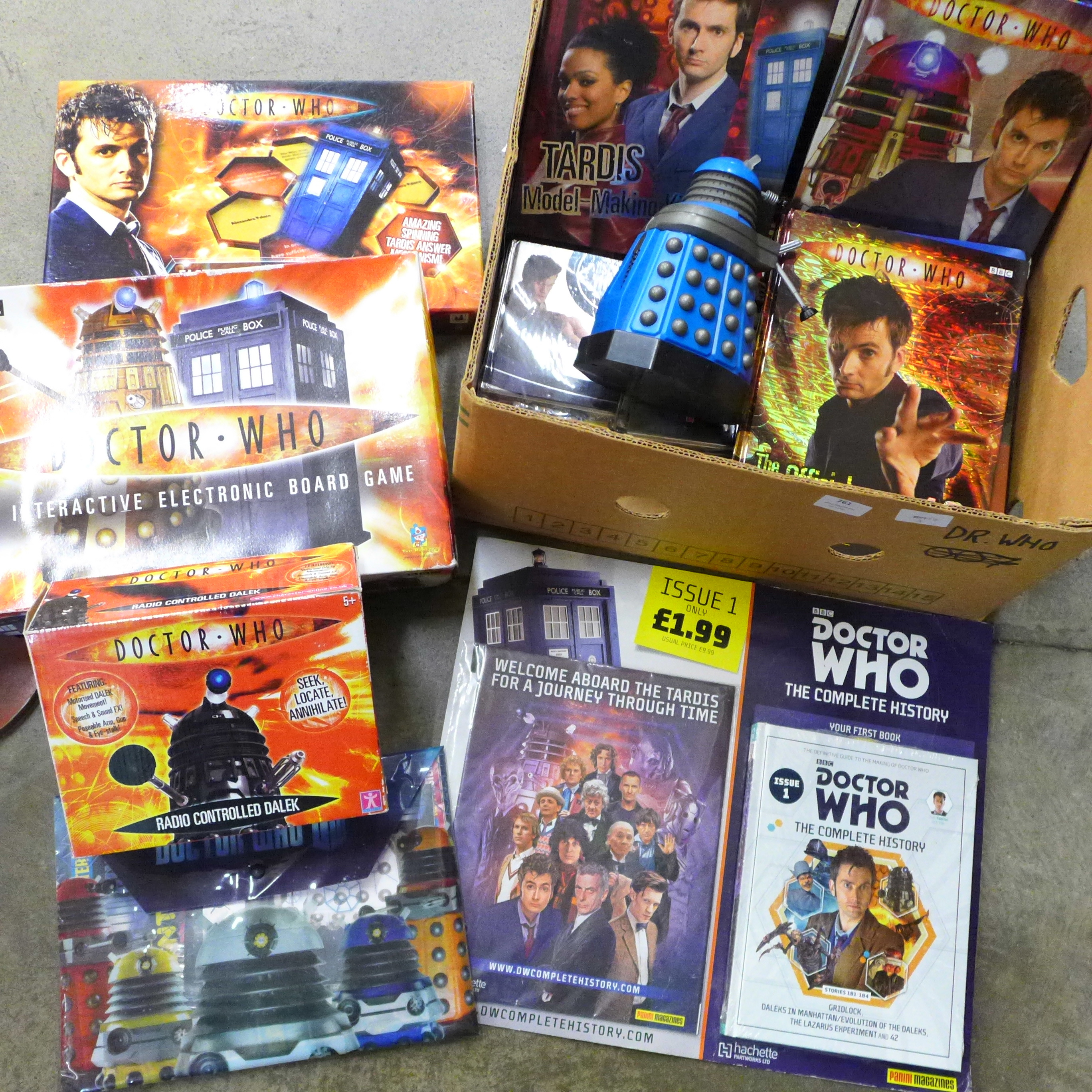 A collection of vintage Doctor Who merchandise and games, including a radio controlled Dalek