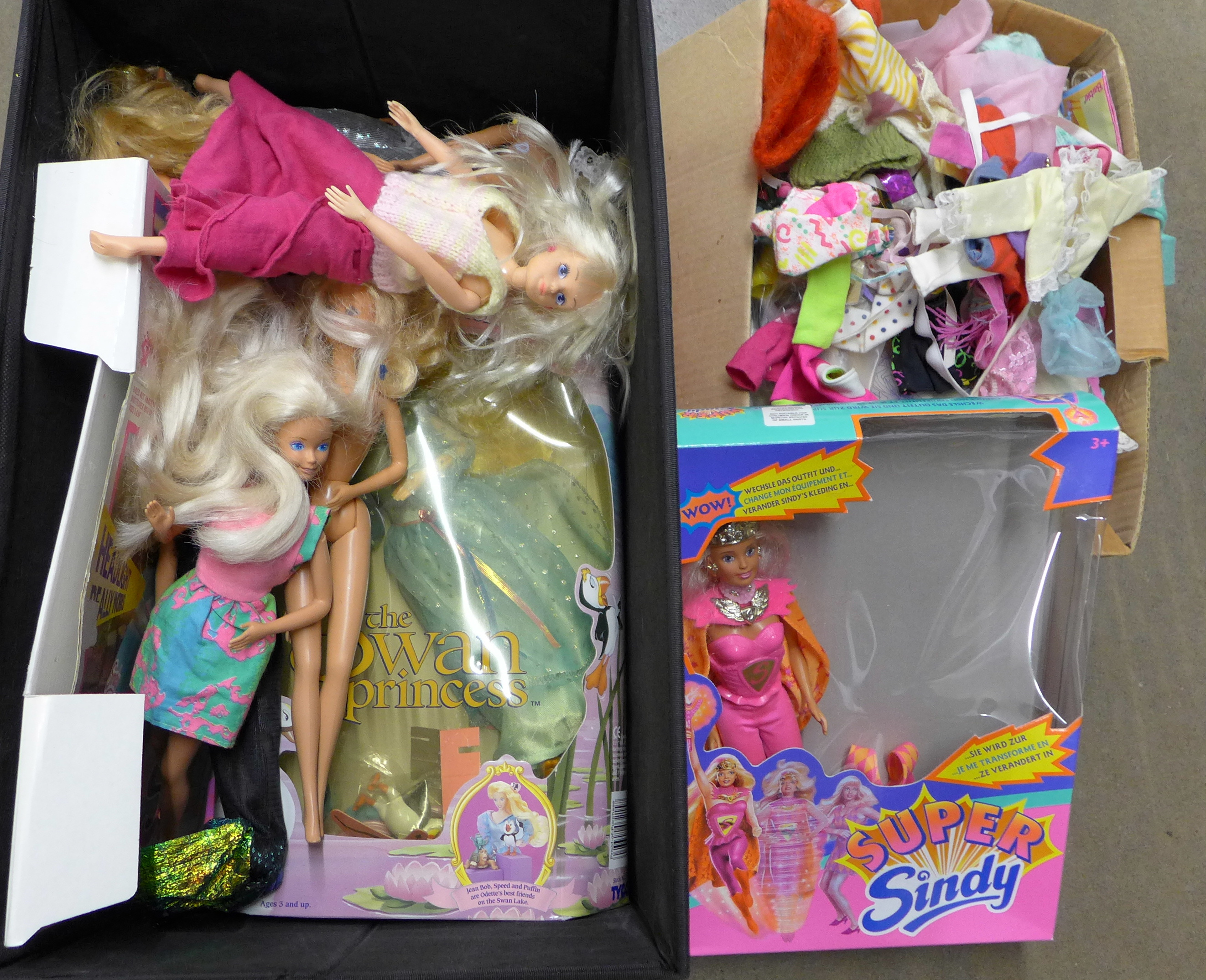 A box of Sindy dolls and others, including clothes and accessories **PLEASE NOTE THIS LOT IS NOT