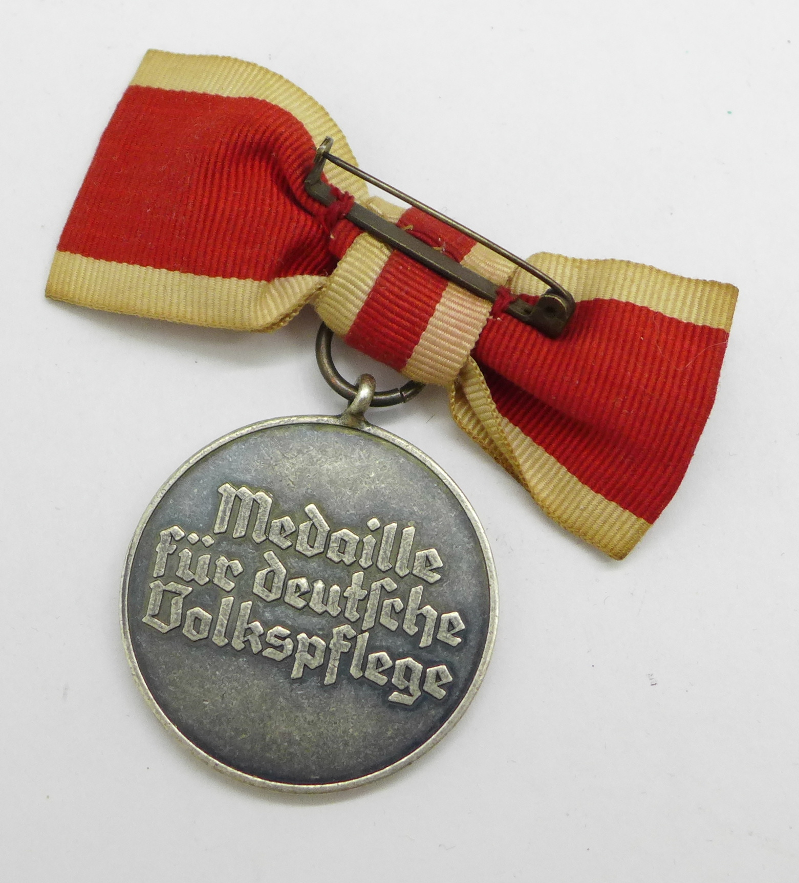 A WWII German Social Welfare for women medal - Image 2 of 2