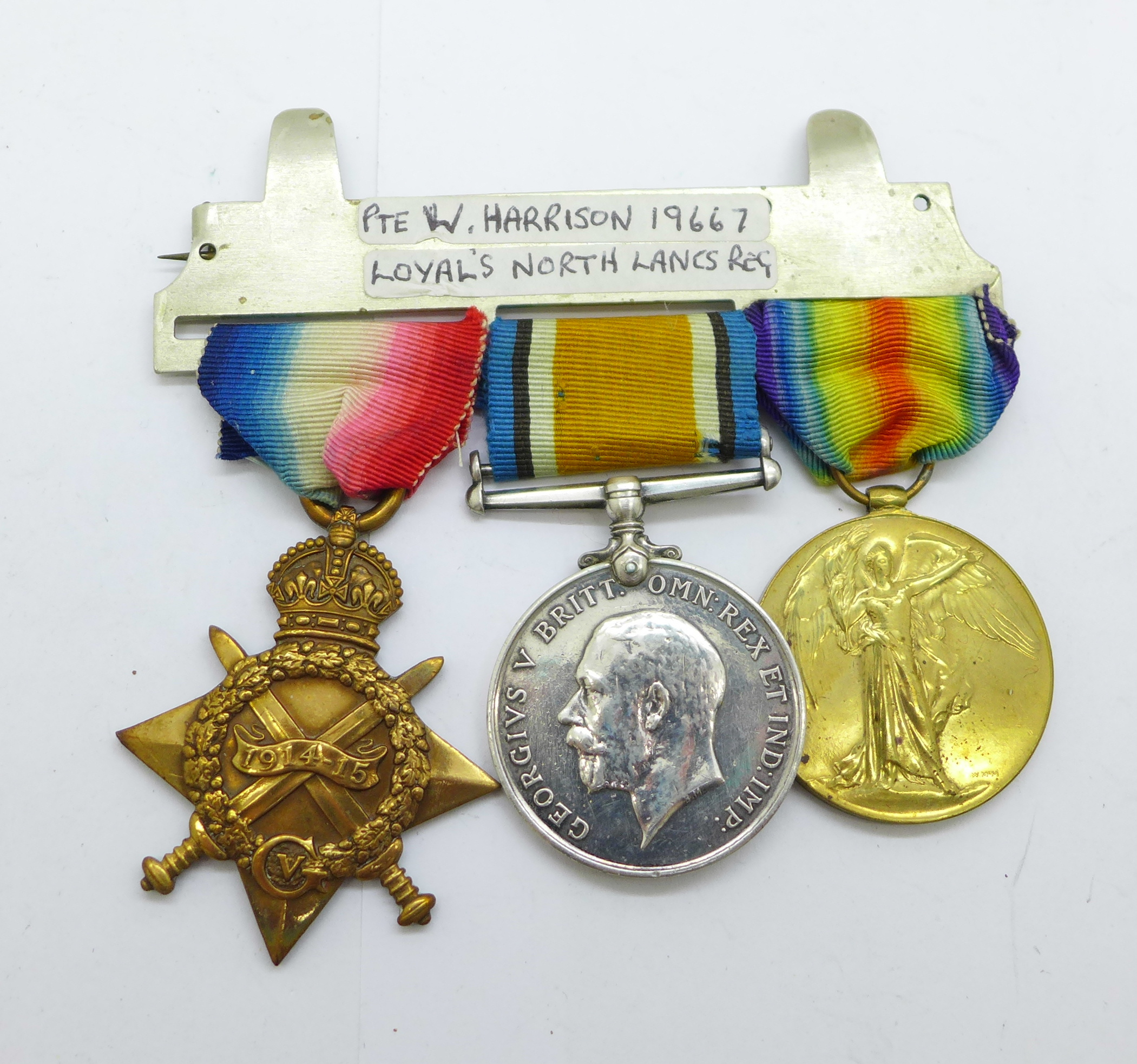 A trio of WWI medals to 19667 Pte. W. Harrison. L. N. Lan. R.