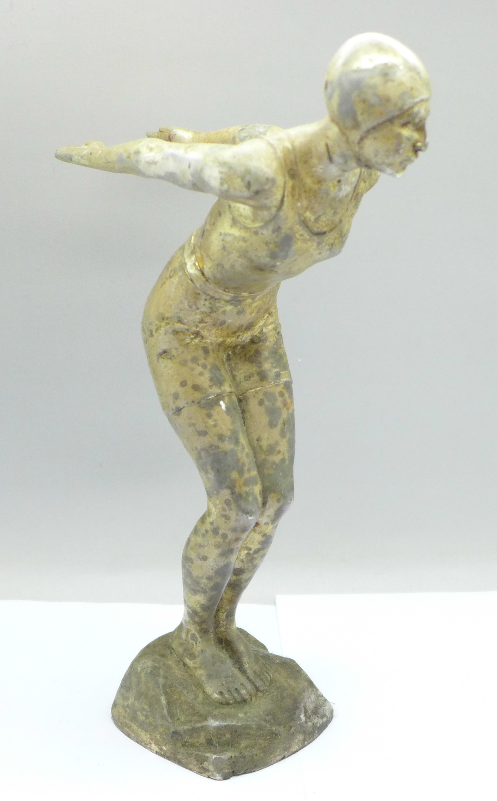 An Art Deco cast metal figure of a female swimmer, 24.5cm