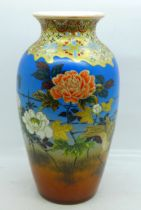 A Japanese vase with gilt and enamel decoration, 20cm