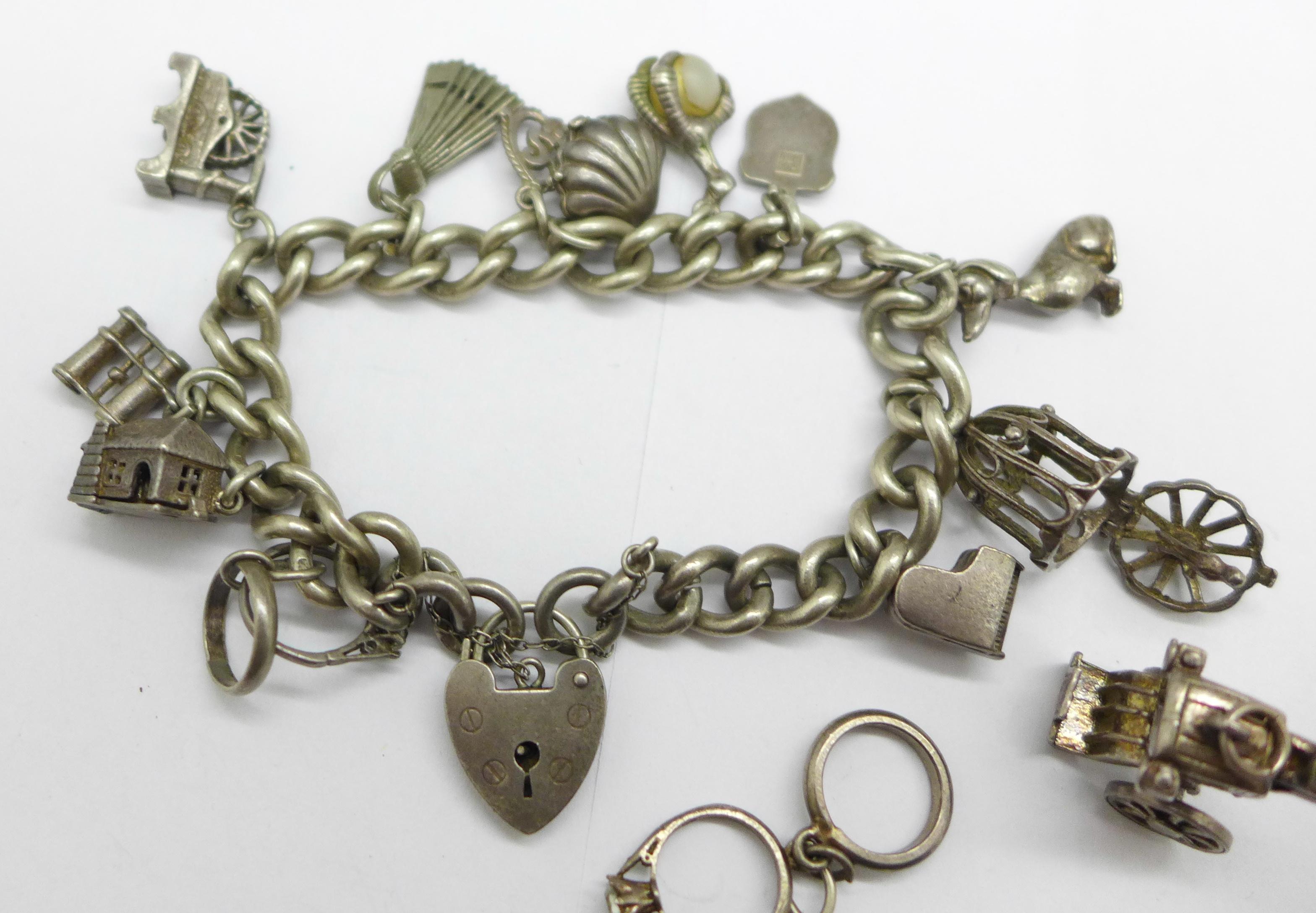 A silver charm bracelet, 68g - Image 2 of 2