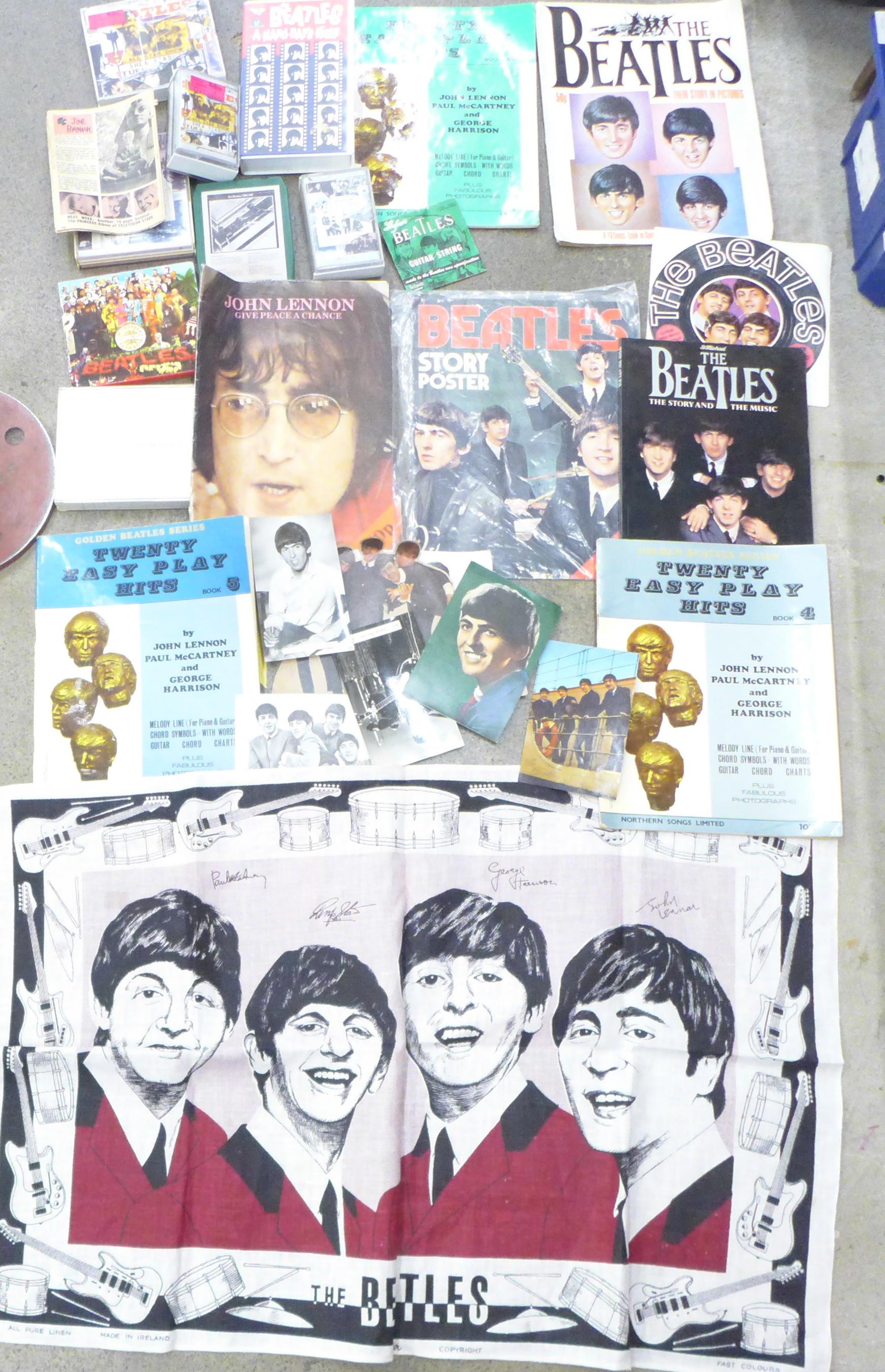 Beatles memorabilia including tea towel, postcards, promotional photograph, EasyPlay Hits songbooks,