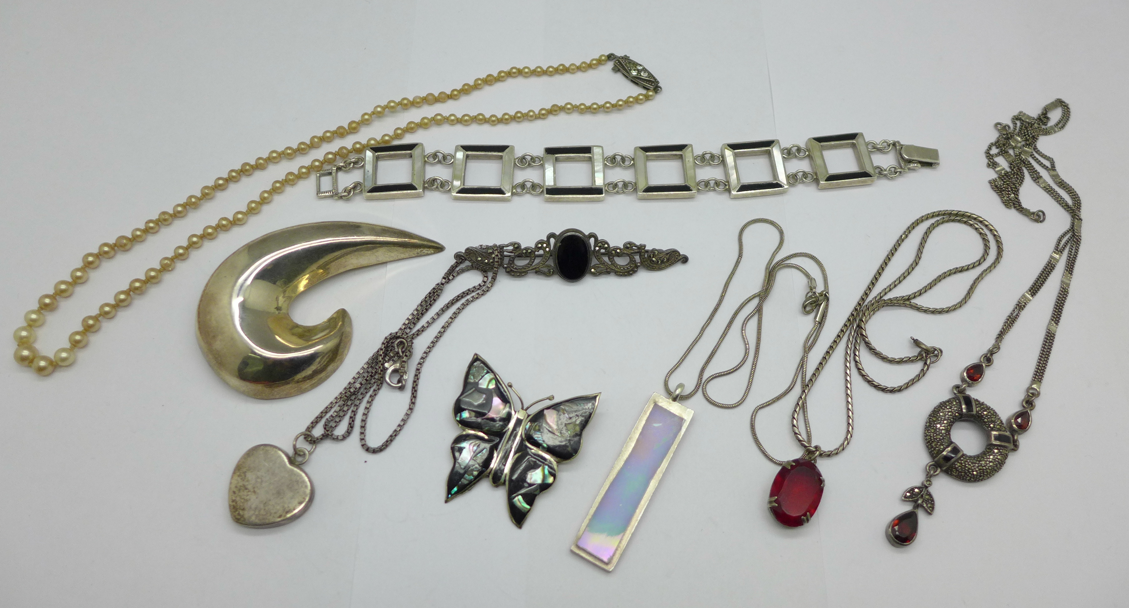 Three silver brooches, a silver bracelet, three pendants and chains, a necklace lacking fastener and