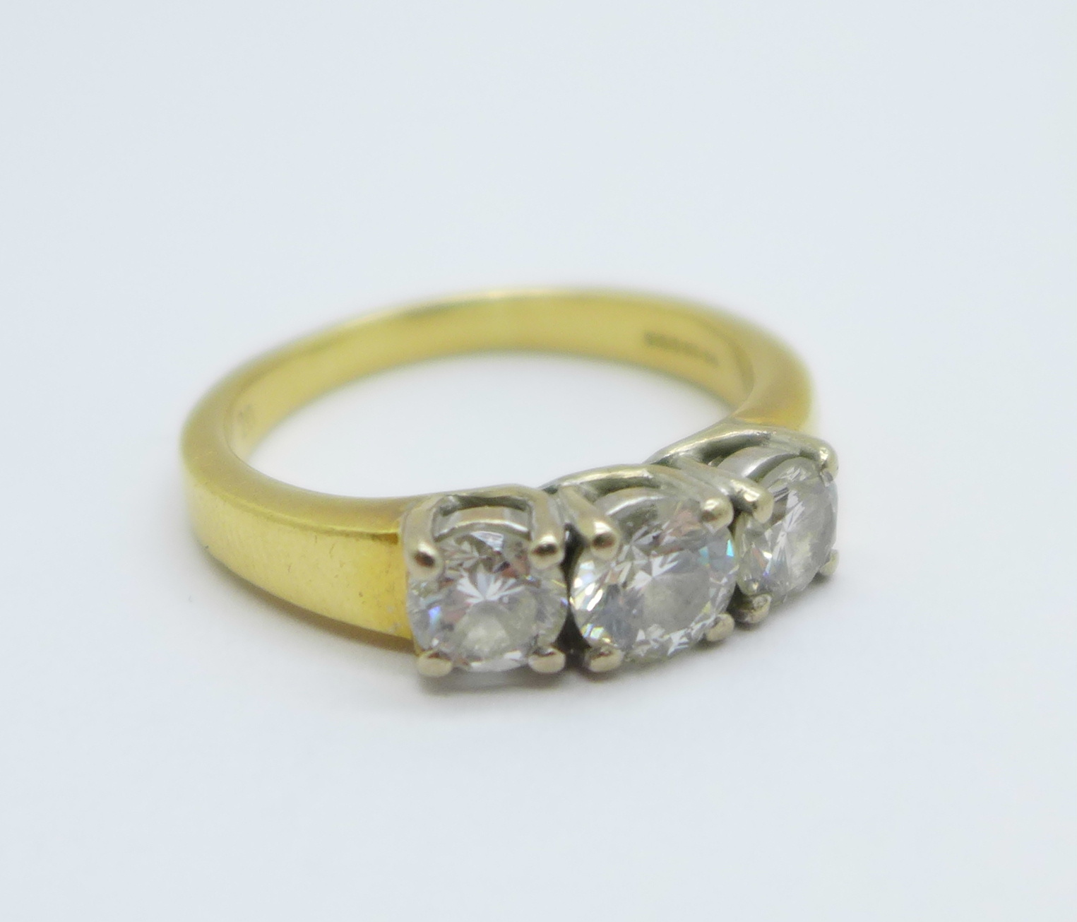 An 18ct yellow gold three stone diamond ring, approximately 1.25 carat total diamond weight, 8.6g, V - Image 6 of 6