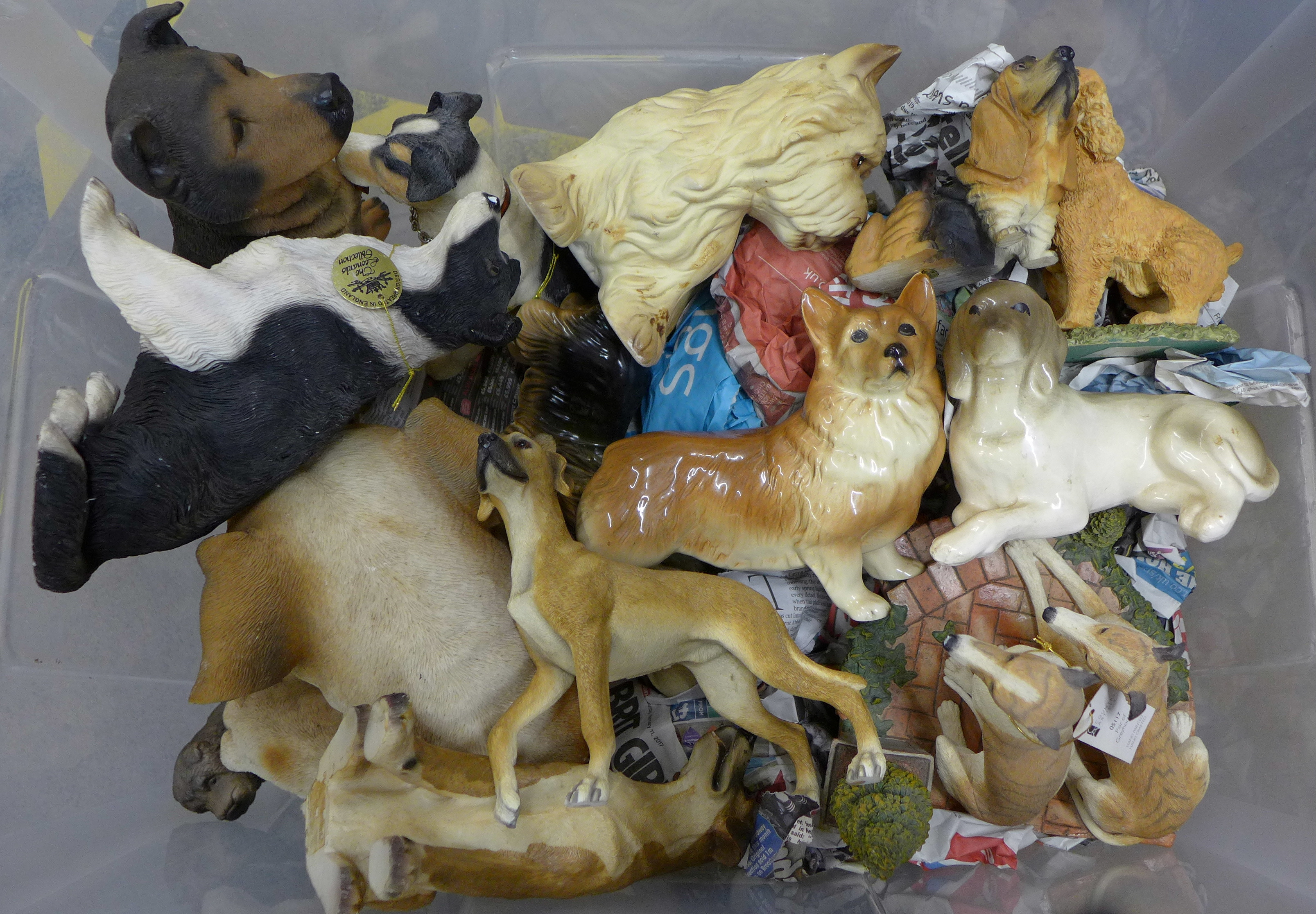 A collection of china dog figures **PLEASE NOTE THIS LOT IS NOT ELIGIBLE FOR POSTING AND PACKING**