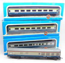 Three Airfix System 00 scale 'Inter City' coaches, boxed and a Lima coach