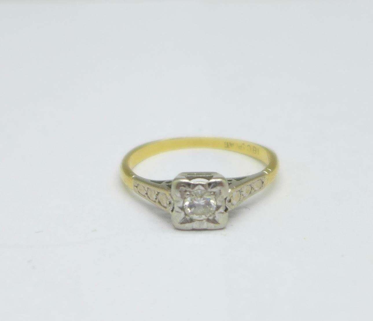 An 18ct gold and platinum set diamond ring, 2.3g, L