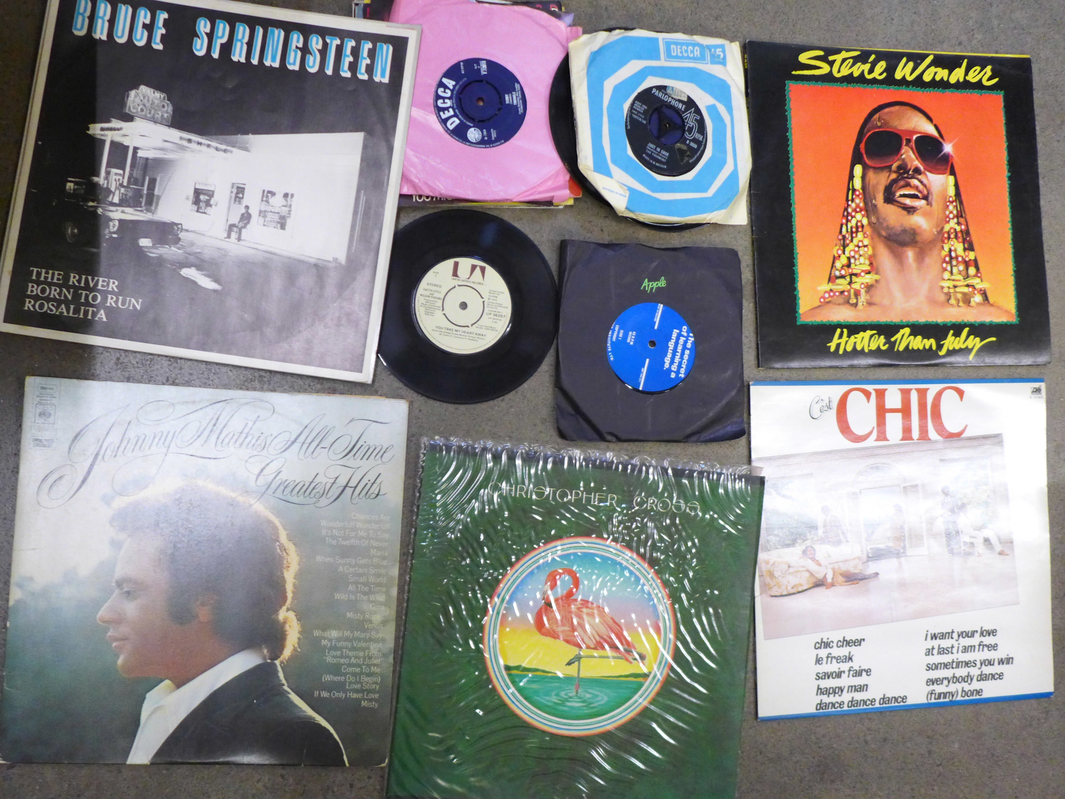 """A collection of LP records and 7"""" 45rpm singles including Bruce Springsteen, 10cc, Gladys Knight,"""