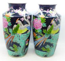 A pair of Japanese famille noir vases, 24cm