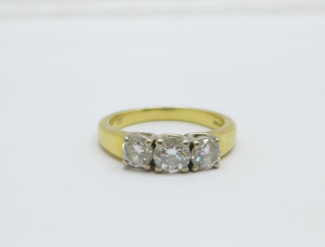 An 18ct yellow gold three stone diamond ring, approximately 1.25 carat total diamond weight, 8.6g, V
