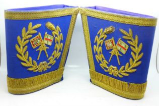 A pair of military brassard armlets, one marked Toye & Co. Ltd