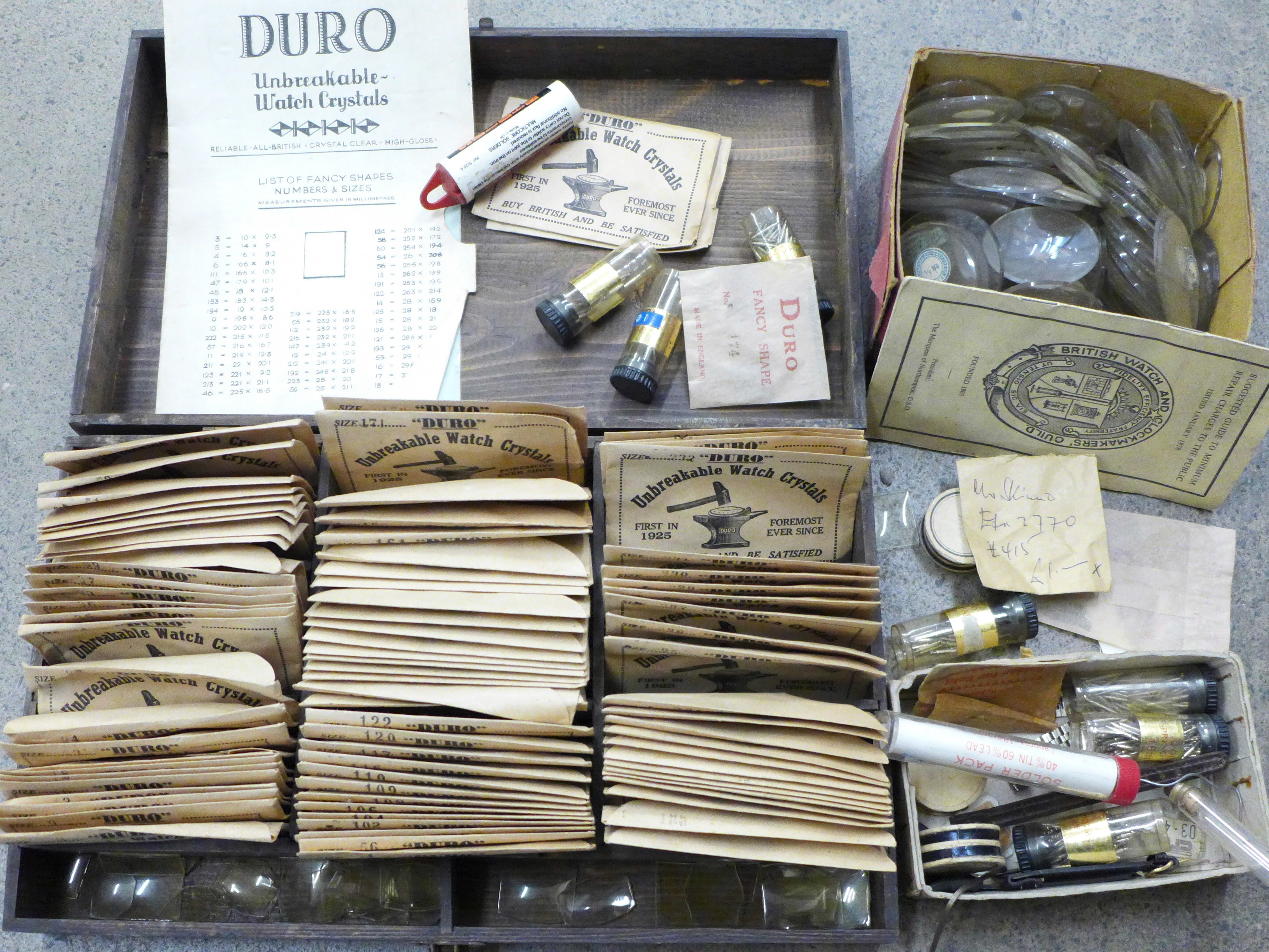 A case of Duro unbreakable watch crystals, fancy and unusual shapes, with order booklet (saleman's