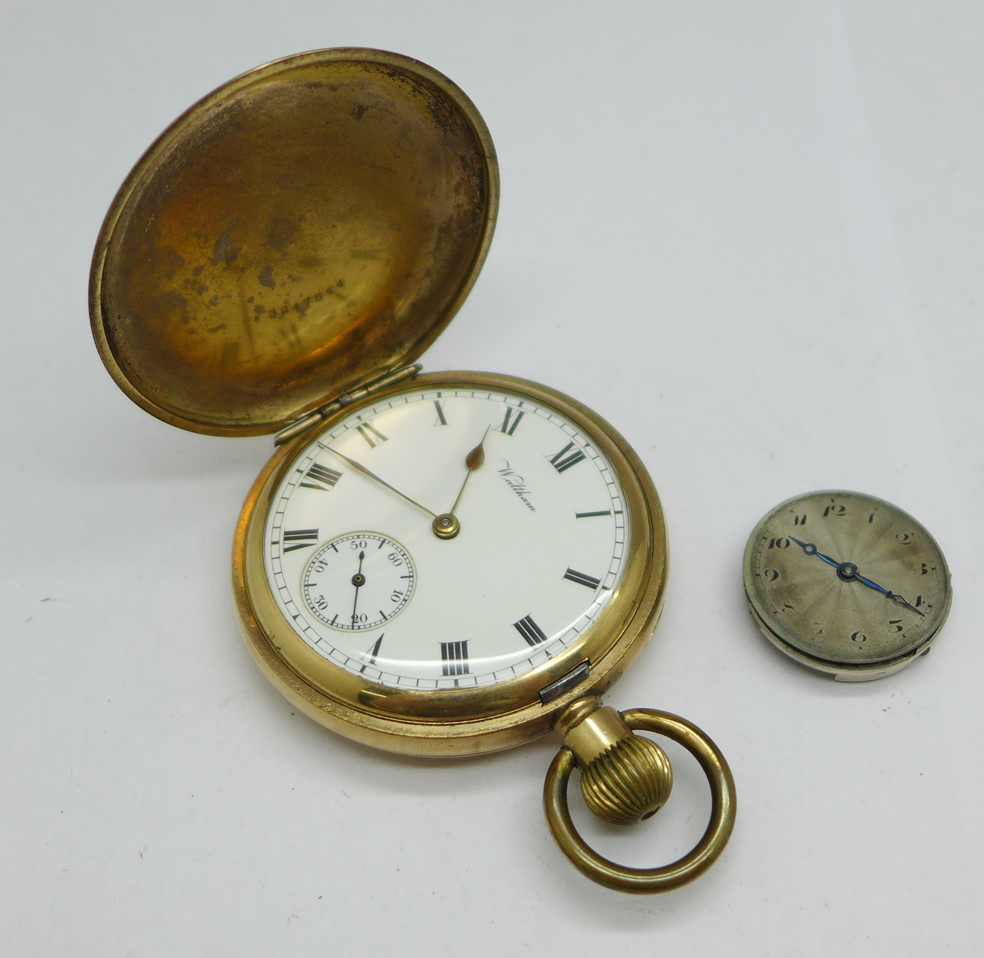 A Rolex wristwatch movement, 23mm, and a Waltham Giant gold plated full hunter pocket watch