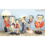 A collection of six Betty Boop figures, figure with umbrella a/f