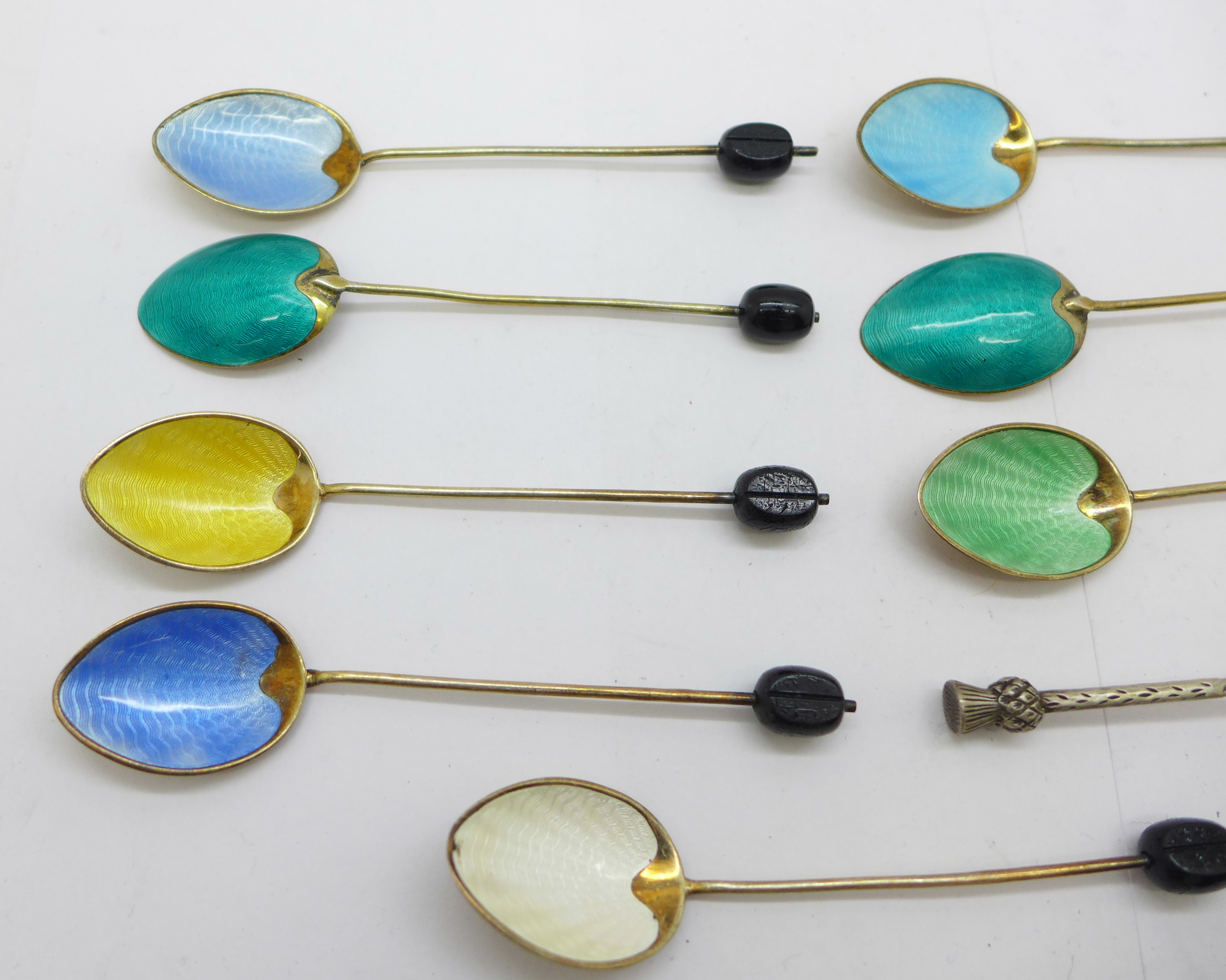 Eight silver and enamel coffee bean spoons, (6+2), and a silver thistle spoon, 72g - Image 2 of 5