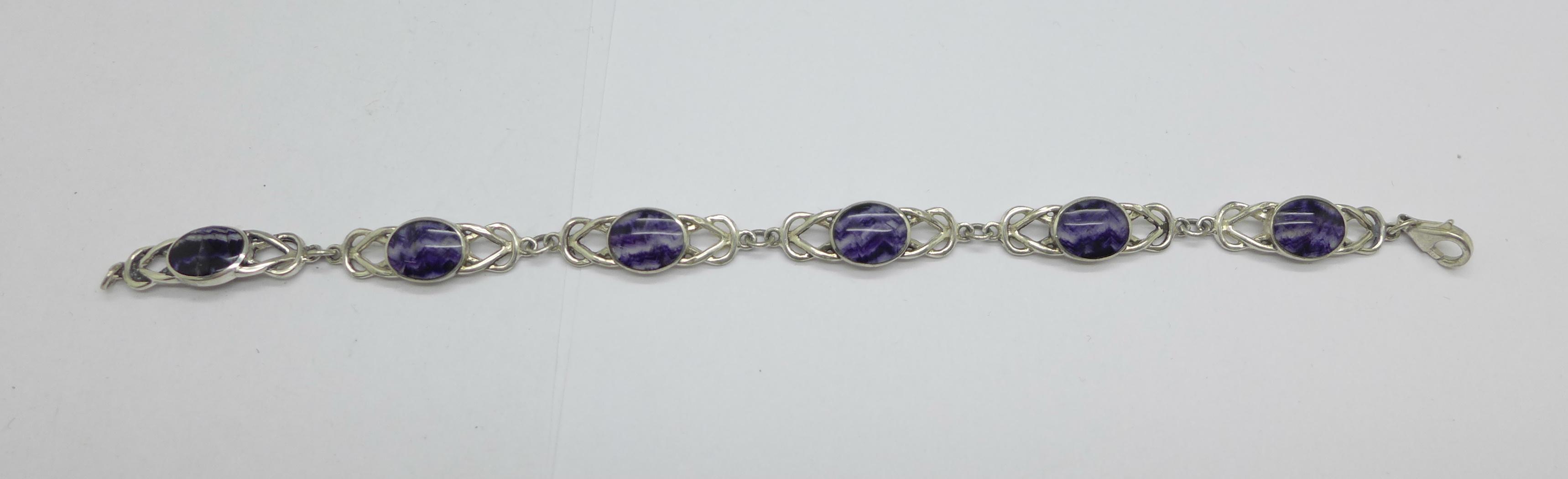 A modern silver Celtic knot and Blue John bracelet, one panel a/f