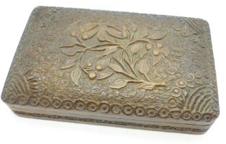 A heavily carved wooden box