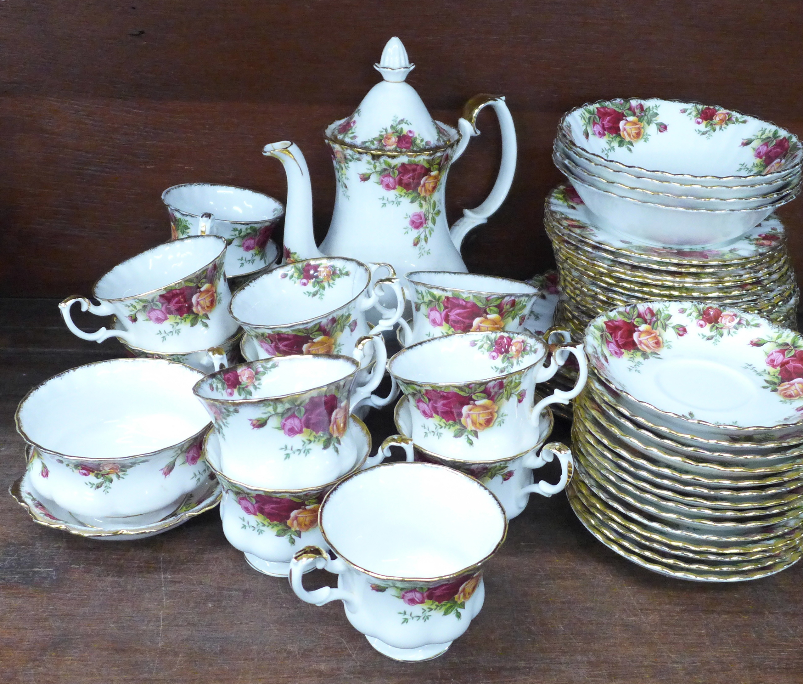 Royal Albert Old Country Roses china:- coffee pot, thirteen cups, fourteen saucers, eighteen side