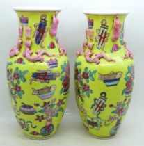 A pair of Chinese vases, 21.5cm, crazed