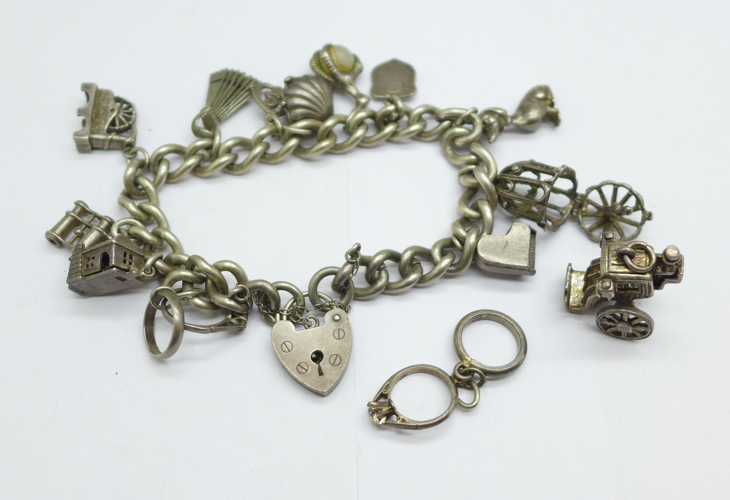 A silver charm bracelet, 68g