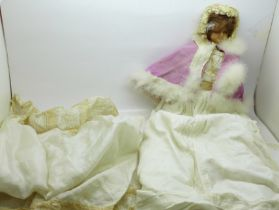 A 19th Century doll with wax head and limbs with bonnet