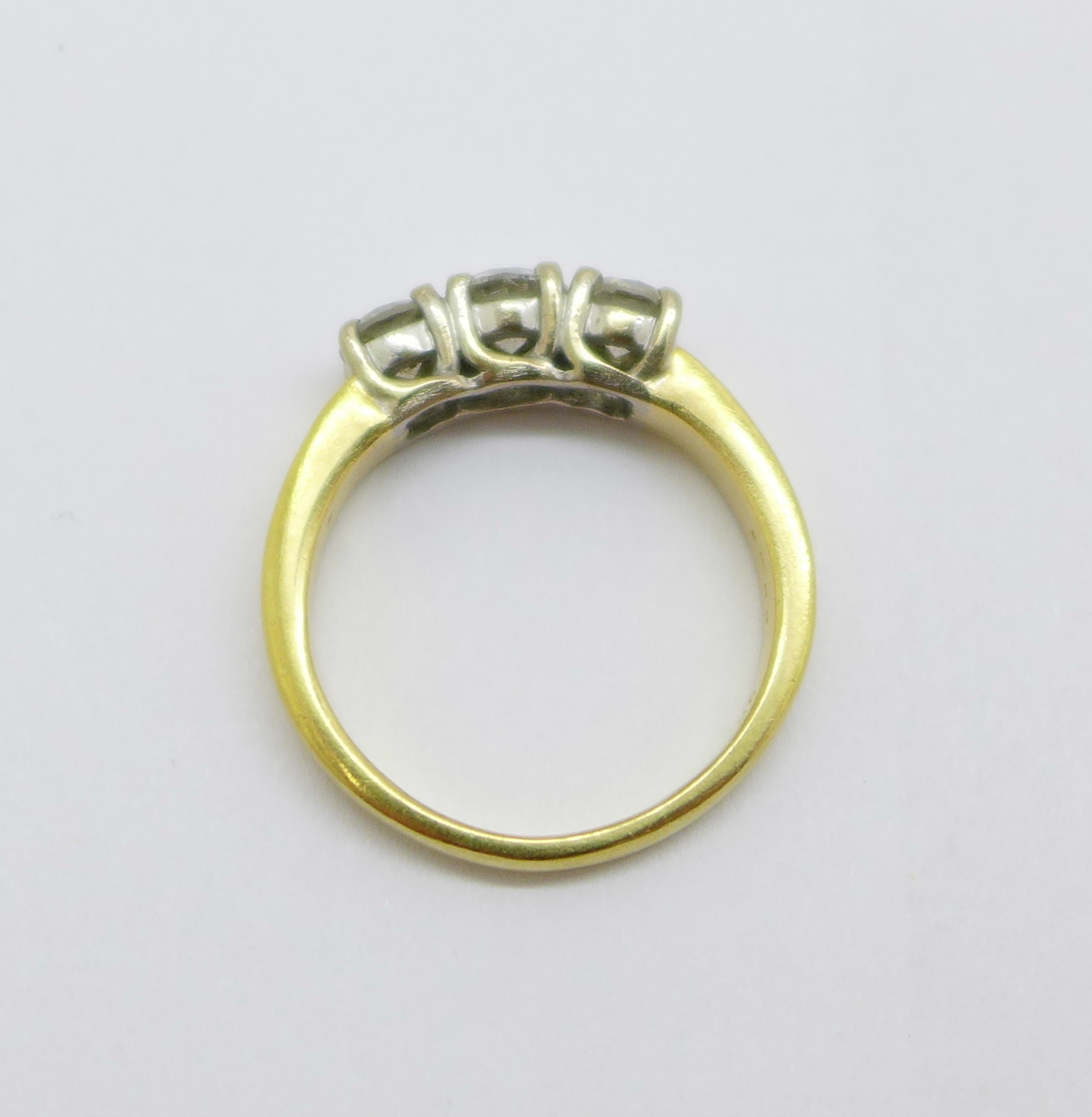 An 18ct yellow gold three stone diamond ring, approximately 1.25 carat total diamond weight, 8.6g, V - Image 4 of 6
