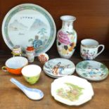 A collection of Chinese and Japanese ceramics including a vase, small plates, mugs and a larger