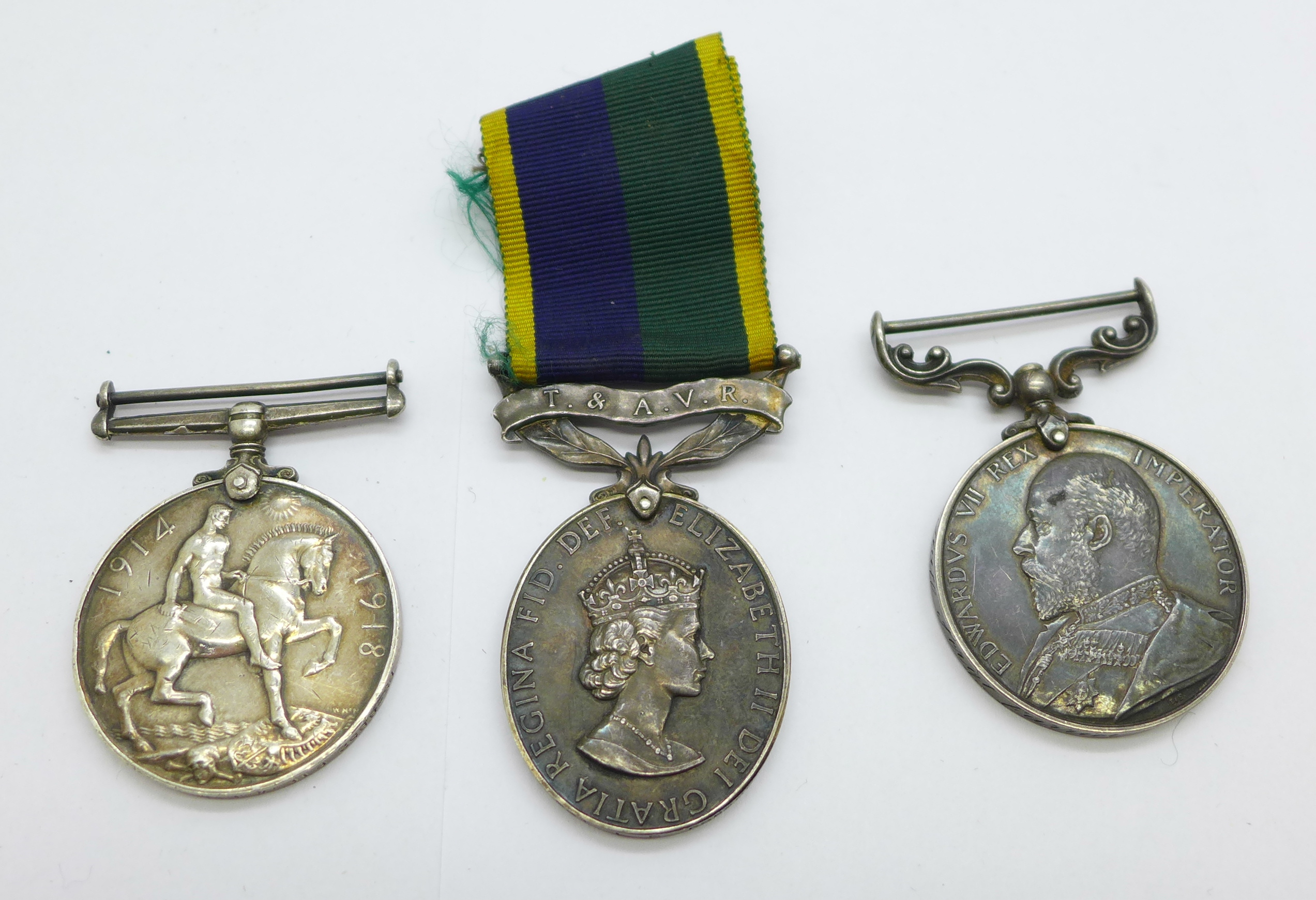 Three medals; WWI British War Medal to PS-8852 Pte W E Morgan R Fus, an Edward VII For Long