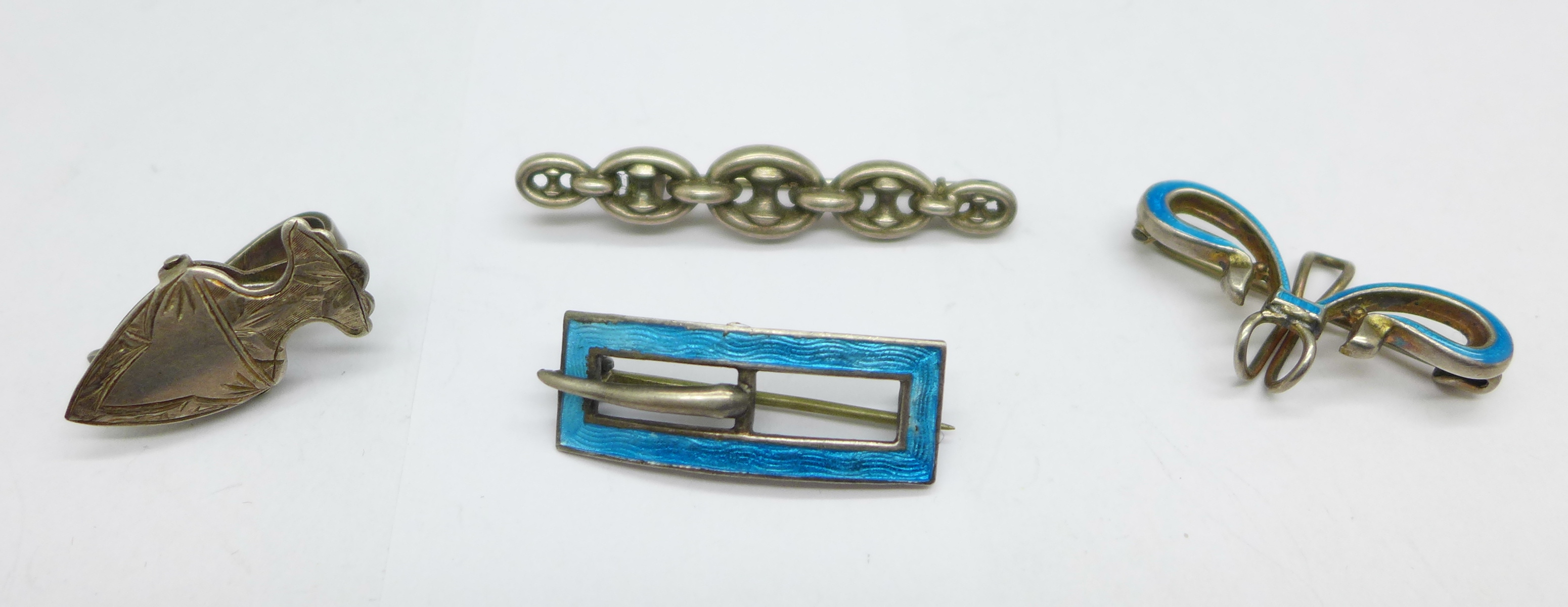 A silver and enamel Charles Horner brooch in the form of a buckle, Chester 1912, a silver and