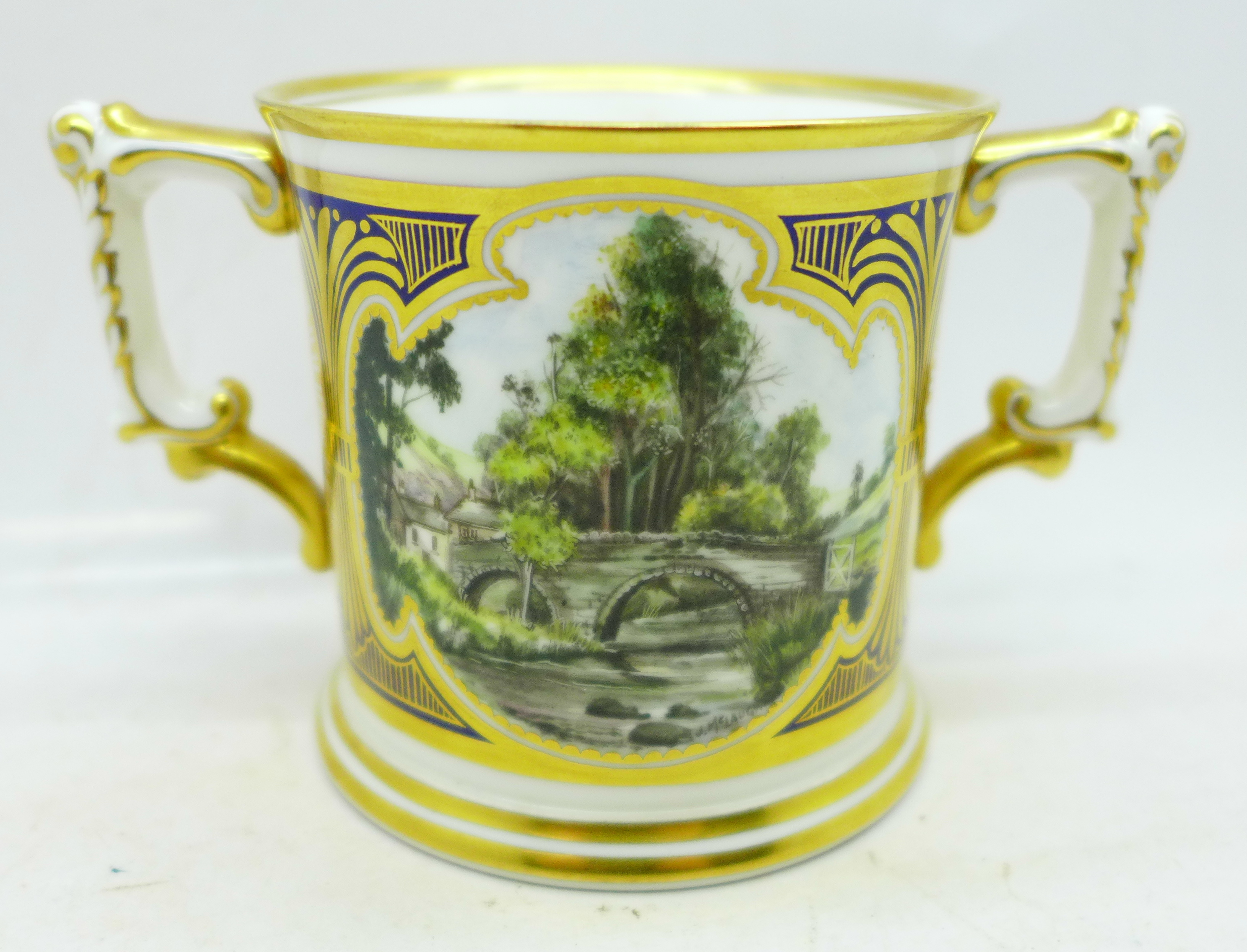 A small Royal Crown Derby Dovedale and Mill Dale mug, signed J McLaughlin