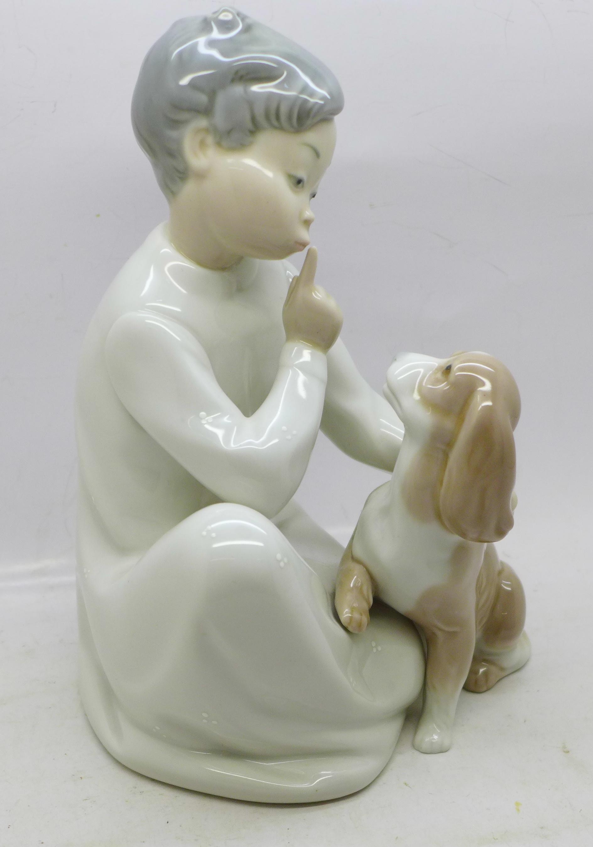 A Lladro figures, boy with dog, 19.5cm