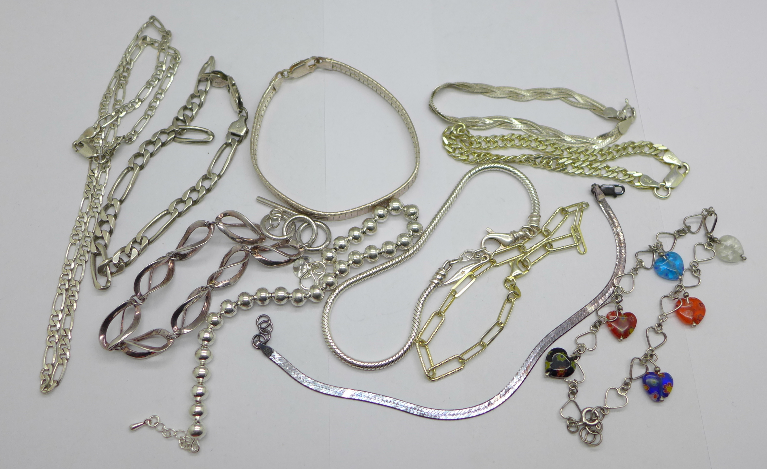 Ten silver bracelets and a silver necklace, 95g