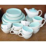 Poole Pottery tea wares, teapot, ten cups, eight saucers, twenty plates of various size, cream and