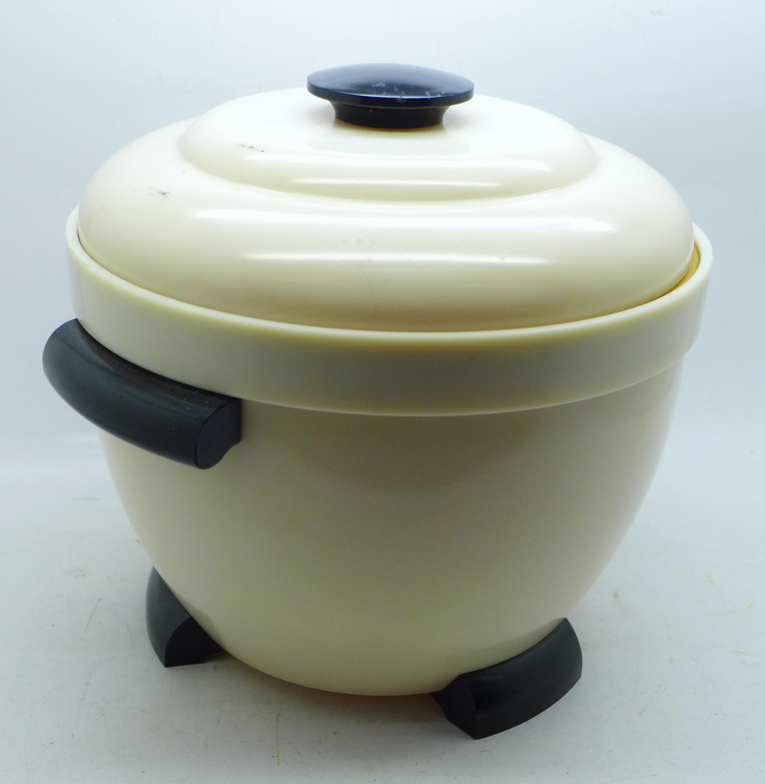 An Art Deco Bakelite ice bucket