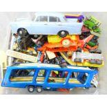 A box of die-cast vehicles, playworn