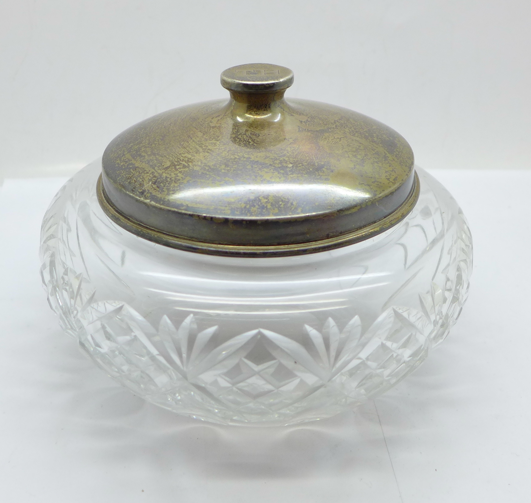 A large silver topped glass jar, the lid marked sterling silver and weighs 72g, diameter of glass