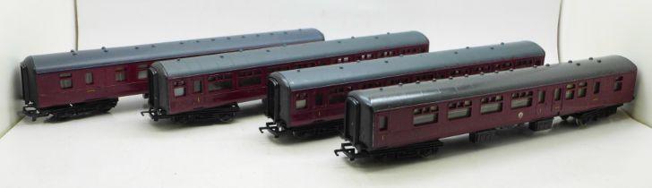 Four Hornby OO gauge model railway carriages