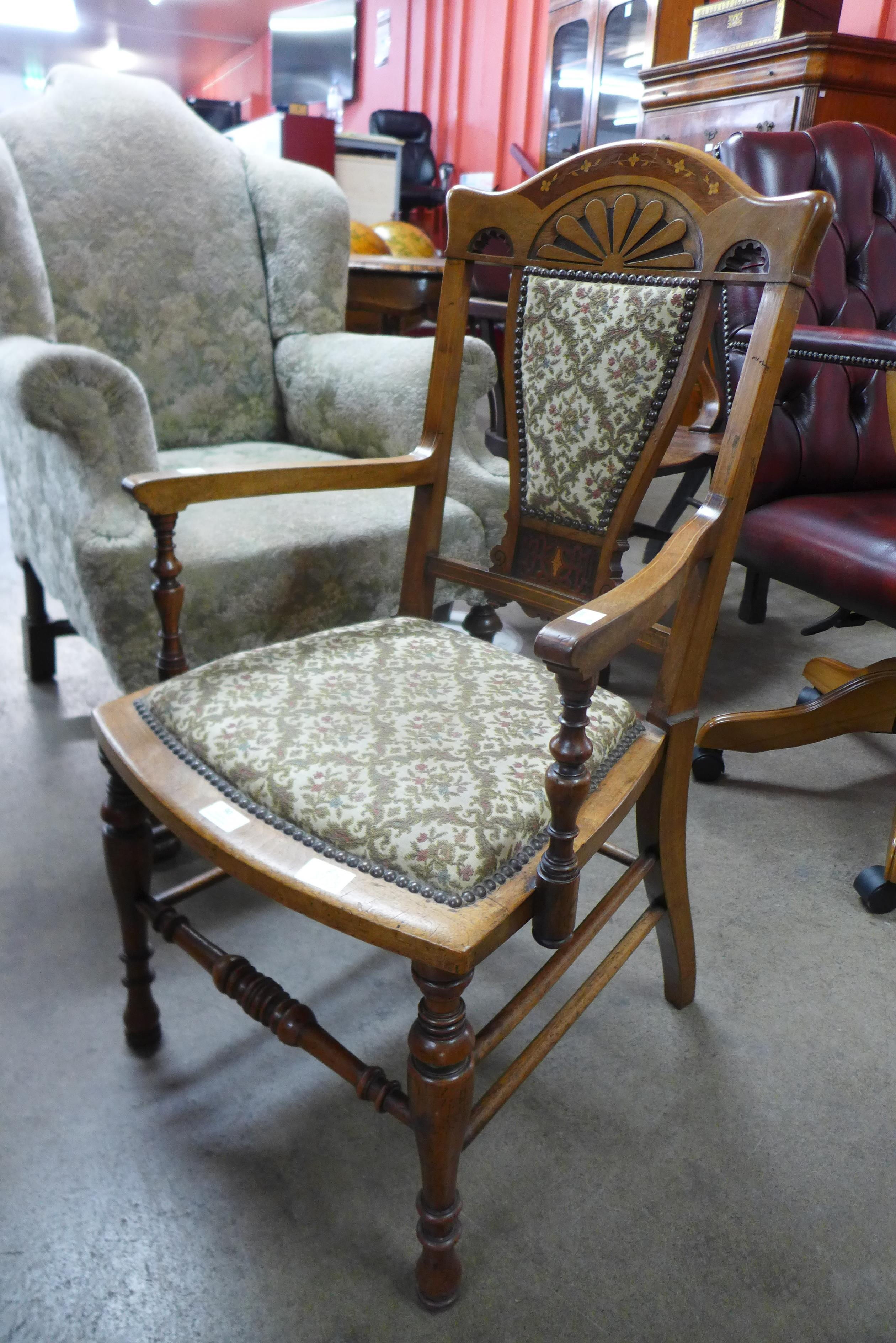 A Victorian Aesthetic Movement inlaid walnut elbow chair