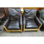 A pair of ash and chocolate leather armchairs