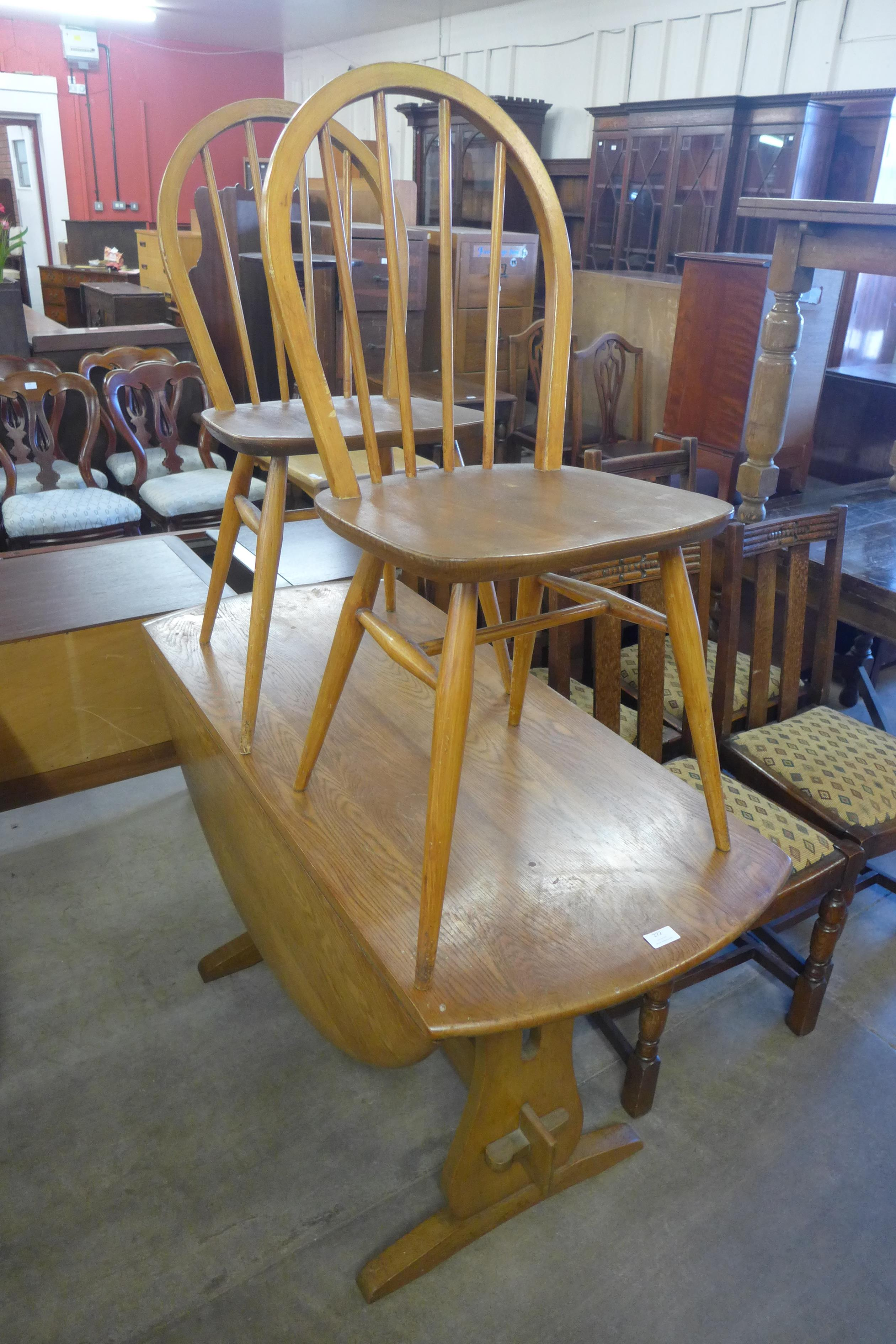An elm dropleaf table and two chairs